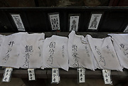 White robes worn by pilgrims, known as henro, donated and displayed at  Ishite temple, on completion of the Shikoku 88 temple pilgrimage. Matsuyama, Eihime, Japan.. Friday, June 26th 2015