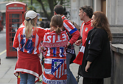 © Licensed to London News Pictures. London, UK. 30/04/2014. London, UK.  Athletico Madrid fans are seen in Trafalgar Square, London, ahead of the semi-final Champions League football game tonight (30/04/14) at Stamford Bridge.Photo credit: Isabel Infantes /LNP