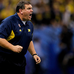 January 3, 2012; New Orleans, LA, USA; Michigan Wolverines head coach Brady Hoke reacts from the bench during the fourth quarter of the Sugar Bowl against the Virginia Tech Hokies at the Mercedes-Benz Superdome. Michigan defeated Virginia 23-20 in overtime. Mandatory Credit: Derick E. Hingle-US PRESSWIRE