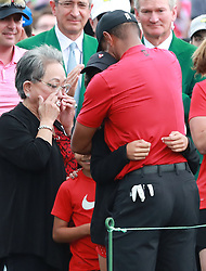 Tiger Woods' mother Kultida Woods wipes away tears as he hugs his daughter Sam and son Charlie behind the 18th green after winning the Masters on Sunday, April 14, 2019, in Augusta, GA, USA. Photo byCurtis Compton/Atlanta Journal-Constitution/TNS/ABACAPRESS.COM