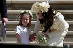 The Duchess of Cambridge with Princess Charlotte leave St George's Chapel in Windsor Castle after the wedding of Prince Harry and Meghan Markle.