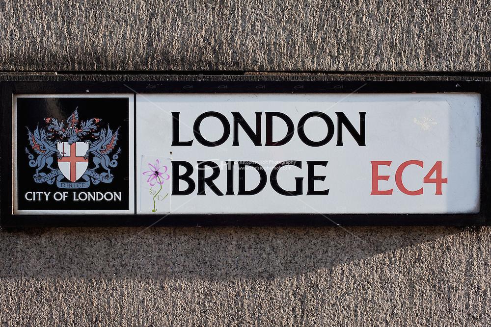 london bridge sign on stone wall