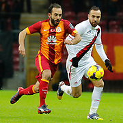 Galatasaray's Olcan Adin (L) and Balikesirspor's Sercan Yildirim (R) during their Turkish Super League soccer match Galatasaray between Balikesirspor at the AliSamiYen Spor Kompleksi TT Arena at Seyrantepe in Istanbul Turkey on Monday, 16 February 2015. Photo by Aykut AKICI/TURKPIX