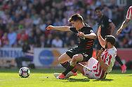 Liverpool's Ben Woodburn is fouled by Erik Pieters of Stoke city.  Premier league match, Stoke City v Liverpool at the Bet365 Stadium in Stoke on Trent, Staffs on Saturday 8th April 2017.<br /> pic by Bradley Collyer, Andrew Orchard sports photography.