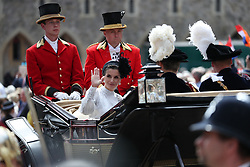 Queen Letizia of Spain waves from a horse drawn carriage during the annual Order of the Garter Service at St George's Chapel, Windsor Castle.