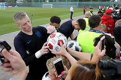 England goalkeeper Jordan Pickford signs autographs for fans during the training session at the Spartak Zelenogorsk Stadium, Repino.