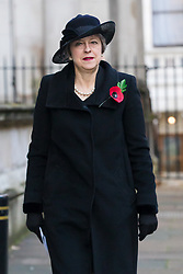 © Licensed to London News Pictures. 10/11/2019. London, UK. Former Prime Minister, Theresa May walks through Downing Street to attend the Remembrance Sunday Ceremony at the Cenotaph in Whitehall. Remembrance Sunday events are held across the country today as the UK remembers and honours those who have sacrificed themselves in two world wars and other conflicts. Photo credit: Vickie Flores/LNP