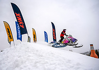 """Felecia Koch, of Lyman, Wyoming, shoots through the starting gate during the Women's Stock Qualifiers of the World Championship Snowmobile Hill Climb on Thursday at Snow King Mountain. The 44th annual event continues through the weekend, with Pro Finals and """"King of the Mountain"""" runs scheduled for Sunday."""