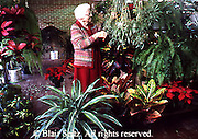 Active Aging Senior Citizens, Retired, Activities, Elderly Woman Cares for Plants, Retirement Community