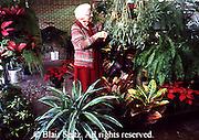 Active Aging Senior Citizens, Retired, Activities, Elderly Woman Cares for Plants, Retirement Community