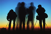 "Silhouettes of four photographers at sunrise on Mount Nemrut, in the Republic of Turkey. Published in ""Light Travel: Photography on the Go"" book by Tom Dempsey 2009, 2010."