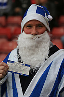 Football - 2017 / 2018 Premier League - Southampton vs. Huddersfield Town<br /> <br /> A Huddersfield Town fan in a blue and white santa outfit with his free drink voucher before kick off at St Mary's Stadium Southampton<br /> <br /> COLORSPORT/SHAUN BOGGUST