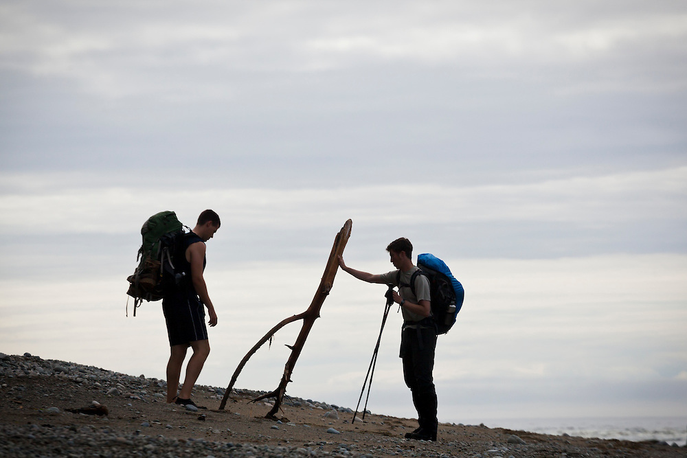 Henry (left) and Zach Podell-Eberhardt play with driftwood on a beach along the West Coast Trail, British Columbia, Canada.