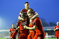 Crawley Town defender Josh Yorwerth (15) celebrates his goal with teammates during the EFL Sky Bet League 2 match between Crawley Town and Newport County at the Checkatrade.com Stadium, Crawley, England on 17 December 2016. Photo by Andy Walter.