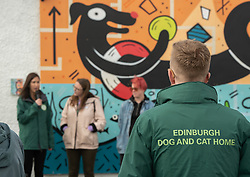 Edinburgh Dog and Cat Home 'unveiled' a colourful 80-foot mural along the Seafield Promenade this morning. The large-scale artwork occupies a wall previously covered in graffiti along the Seafield shoreline. Designed and painted by local artists, Studio N_Name, the mural will embodies the colourful people, heritage and environment of the local community. This project was made possible through a partnership with Edinburgh Shoreline Project, which chose to support the mural as part of their mission to celebrate the city's 27km of coastline. Pictured: Alanna Brady (green jacket), Special Gifts Fundraiser at Edinburgh Dog and Cat Home, Charlotte Johnson, Edinburgh Shoreline project manager<br /> © Jon Davey/ EEm