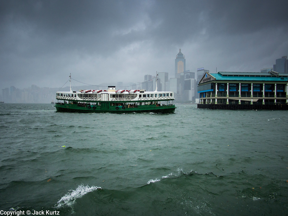 13 AUGUST 2013 - HONG KONG:  A Star Ferry crosses Victoria Harbor in Hong Kong during Typhoon Utor. Typhoon Utor (known in the Philippines as Typhoon Labuyo) is an active tropical cyclone located over the South China Sea. The eleventh named storm and second typhoon of the 2013 typhoon season, Utor formed from a tropical depression on August 8. The depression was upgraded to Tropical Storm Utor the following day, and to typhoon intensity just a few hours afterwards. The Philippines, which bore the brunt of the storm, reported 1 dead in a mudslide and 23 fishermen missing at sea. The storm brushed by Hong Kong bringing several millimeters of rain and moderate winds to the island but causing no reported damage or injuries. It is expected to make landfall in China.  PHOTO BY JACK KURTZ