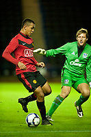 WIDNES, ENGLAND - Tuesday, October 6, 2009: Manchester United's Joshua King in action against Everton's goalkeeper Carlo Nash during the FA Premiership Reserves League (Northern Division) match at the Halton Stadium. (Pic by David Rawcliffe/Propaganda)