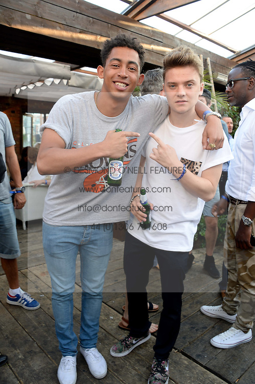 Left to right, JORDAN STEPHENS and CONOR MAYNARD attending the Warner Bros. & Esquire Summer Party held at Shoreditch House, Ebor Street, London E1 on 18th July 2013.