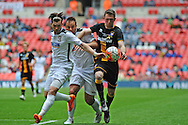 Aaron Birch of Hereford FC battles for the ball with Michael Hall of Morpeth Town AFC during the FA Vase match between Hereford FC and Morpeth Town at Wembley Stadium, London, England on 22 May 2016. Photo by Mike Sheridan.