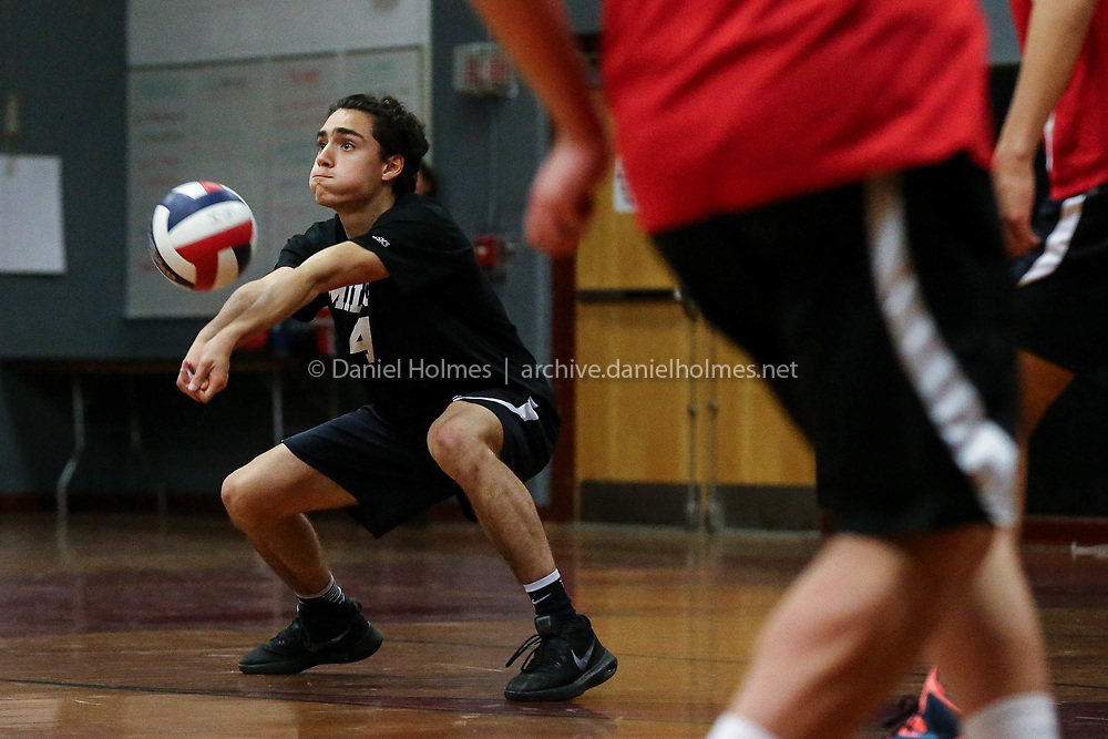 (5/25/17, MILLIS, MA) Milford's Danny Mendoza receives a serve during the first round of the state volleyball tournament against Millis at Millis High School on Thursday. [Daily News and Wicked Local Photo/Dan Holmes]