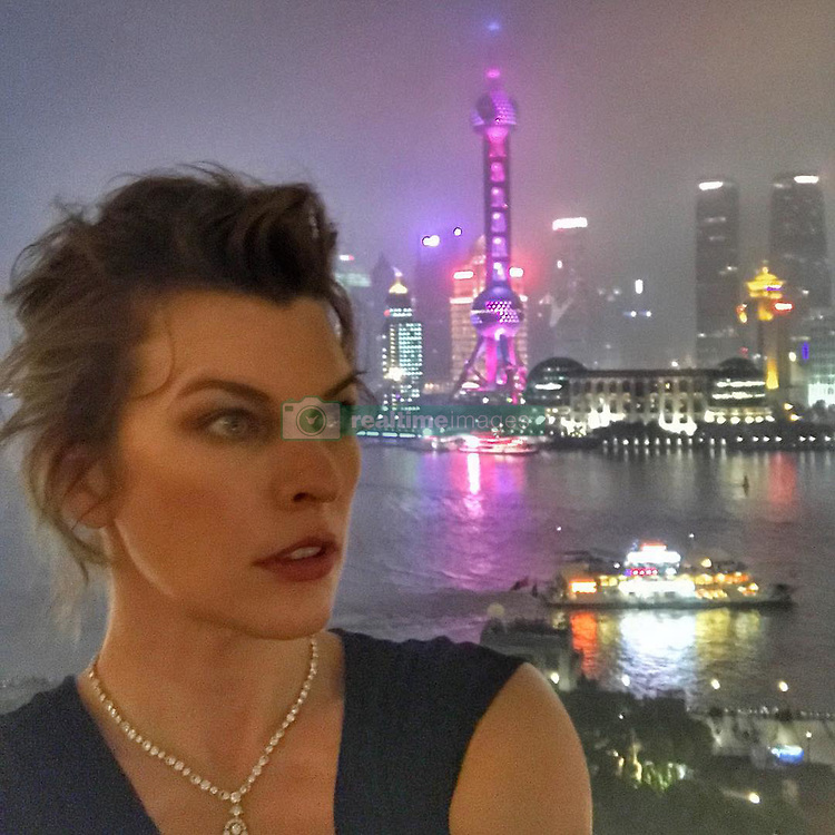 """Milla Jovovich releases a photo on Instagram with the following caption: """"I mean... I wish the view was better.\ud83d\ude09\ud83d\ude02 Shanghai has been such an amazing experience. I want to give a huge thank you to the #shanghaifilmfestival2017 and @melvin0619 for bringing us here to see such insane beauty!\ud83d\udc4f\ud83c\udffc\ud83d\ude4c\ud83c\udffd\ud83d\udc4d\ud83c\udffc#shanghaidiary"""". Photo Credit: Instagram *** No USA Distribution *** For Editorial Use Only *** Not to be Published in Books or Photo Books ***  Please note: Fees charged by the agency are for the agency's services only, and do not, nor are they intended to, convey to the user any ownership of Copyright or License in the material. The agency does not claim any ownership including but not limited to Copyright or License in the attached material. By publishing this material you expressly agree to indemnify and to hold the agency and its directors, shareholders and employees harmless from any loss, claims, damages, demands, expenses (including legal fees), or any causes of action or allegation against the agency arising out of or connected in any way with publication of the material."""