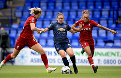 Liverpool Women's Jess Clarke (right) and Manchester United Women's Kirsty Hanson battle for the ball during the Continental Tyres Cup, Group Two North match at Prenton Park, Birkenhead.