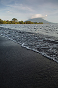 Landscape with distant view of the Maderas volcano and a sandy beach and sea, Ometepe Island, Nicaragua