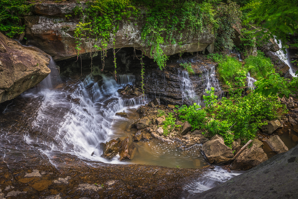 Lying just off Route 16 near Hawks Nest and the New River Gorge is a hidden pocket of waterfalls lining the middle of Laurel Creek filled with lush green vegetation and gaurded by giant boulders.