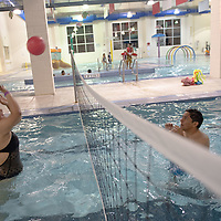Danielle Williams, 22, left, returns the red ball over the net as Skyler Jimmie, 22, right, watches the flight of the ball during the Relay for Life swim night event at the Gallup Aquatic Center in Gallup Friday.