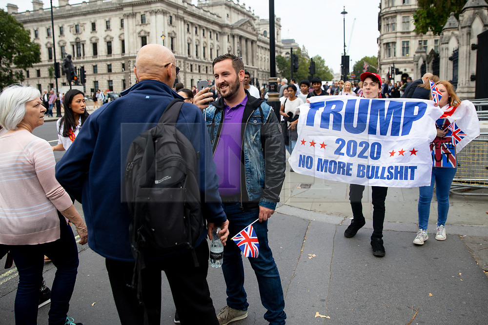 © Licensed to London News Pictures. 05/09/2018. London, UK. NOTE: FILE PHOTO. James Goddard (4R) and Max Hammet-Millay (5R) videos a passerby during a Brexit demonstration in September. The pair have been accused of being part of the group calling Conservative MP Anna Soubry a 'Nazi' on Monday this week. [ORIGINAL CAPTION: Anti-Brexit demonstrators and some far-right sympathisers campaign outside the Houses of Parliament, calling for Britain's immediate exit from the EU, and the re-instating of former Foreign Secretary Boris Johnson.] Photo credit : Tom Nicholson/LNP
