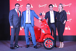 October 3, 2017 - Mumbai, Maharashtra, India - Mumbai, India. 03 October, 2017. L to R Asish Yakhmi (Head Of Two wheeler PVPL), Diego Graffi (MD and CEO PVPL), Farhan Akhtar with Courtney Istre (Director of Partnerships (RED) at the Vespa launches new (RED)® bike in India event at hotel Taj Lands End, Bandra in Mumbai. (Credit Image: © Azhar Khan via ZUMA Wire)