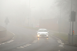 © Licensed to London News Pictures. 12/03/2016<br /> Heavy fog creates difficult driving conditions on North Cray Road in Sidcup, Kent this morning. Photo credit: Grant Falvey