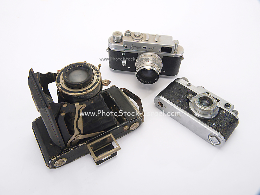three rangefinders cameras on white background