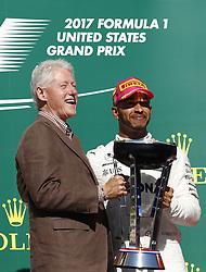 October 22, 2017 - Austin, United States of America - Motorsports: FIA Formula One World Championship 2017, Grand Prix of United States, ..Bill Clinton (Former President of the USA), #44 Lewis Hamilton (GBR, Mercedes AMG Petronas F1 Team) (Credit Image: © Hoch Zwei via ZUMA Wire)