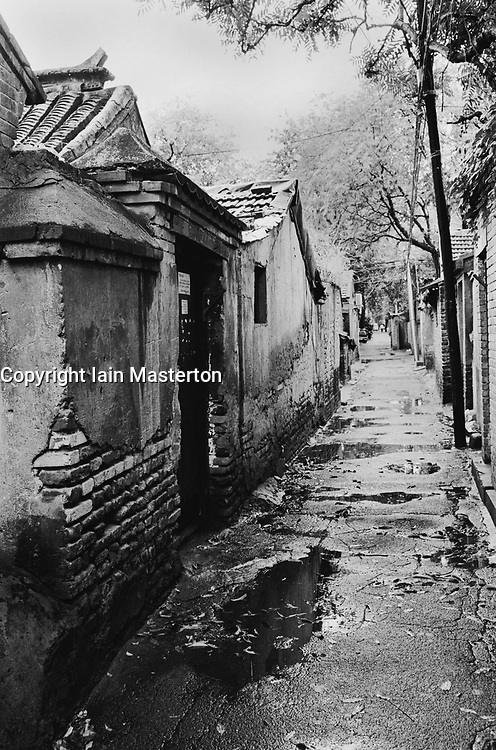 Old hutong in rain in Beijing China