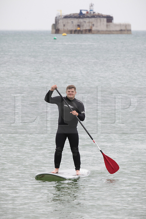 © Rob Arnold.  24/05/2015. Isle of Wight, UK. A man on a paddle board enjoying the Bank Holiday Sunday weather at The Duver beach in St. Helens on the Isle of Wight today, Sunday 24th May 2015. Today started warm with sunny spells, and clouded over later in the day in the South of England. Photo credit : Rob Arnold