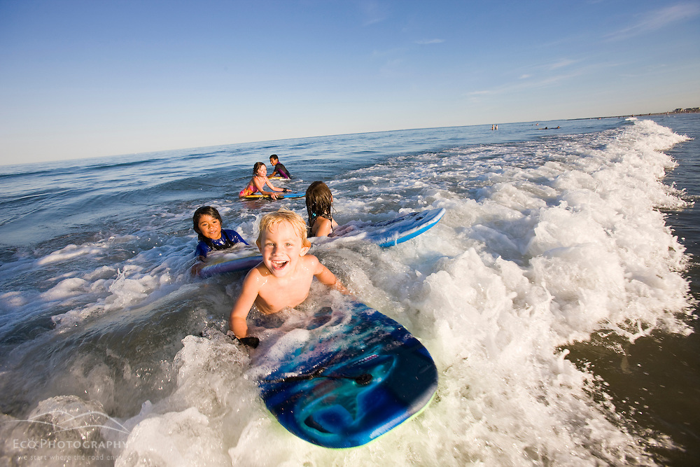 Kids on boogie boards at Hampton Beach in Hampton Beach, New Hampshire.