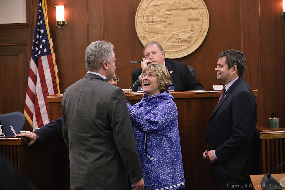 Minority Leader Beth Kerttula (D) (center) laughs with rep. Kyle Johansen (R) while rep. Chris Tuck (D) (right)looks on in the Alaska State House of Representatives.