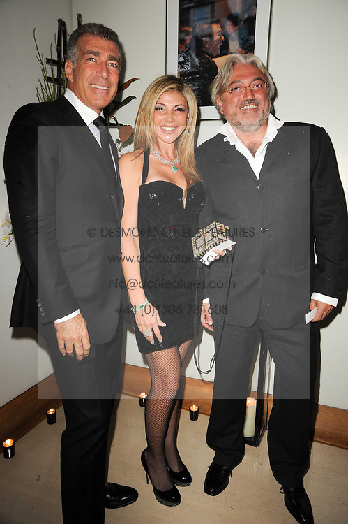 Left to right, STEVE VARSANO, LISA TCHENGUIZ and ROBERT TCHENGUIZ at the launch party for 'Promise', a new capsule ring collection created by Cheryl Cole and de Grisogono held at Nobu, Park Lane, London on 29th September 2010.