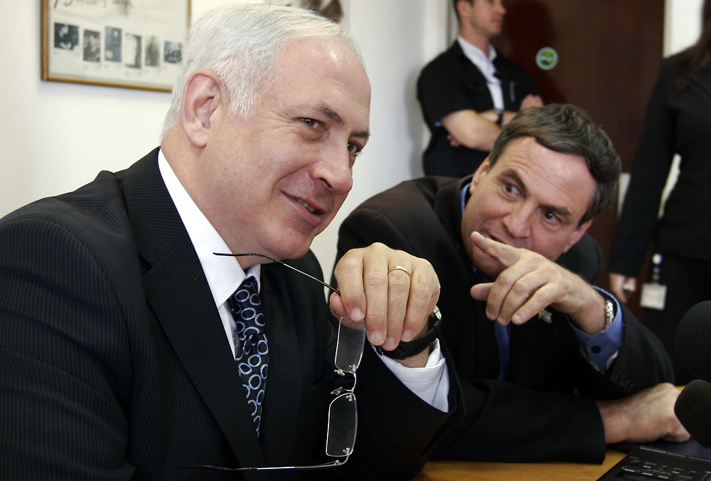 Former Israeli Prime Minister, Israeli Leader of the Opposition and head of the Likud Party Benjamin Netanyahu (L), and former Israeli general Uzi Dayan are seen during a press conference introducing Dayan into the Likud Party, at the Knesset, Israel's parliament in Jerusalem, on July 28, 2008.