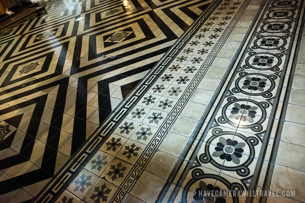 Some of the ornate and distinctive tiling on the floor of the Metropolitan Cathedral of Santiago (Catedral Metropolitana de Santiago) in the heart of Santiago, Chile, facing Plaza de Armas. The original cathedral was constructed during the period 1748 to 1800 (with subsequent alterations) of a neoclassical design.
