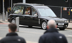 © Licensed to London News Pictures . 18/03/2016 . Manchester , UK . A hearse carrying the coffin arrives at the service . Television stars and members of the public attend the funeral of Coronation Street creator Tony Warren at Manchester Cathedral . Photo credit : Joel Goodman/LNP