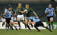 Photo: Richard Lane.<br />South Africa v Uruguay, Pool C at the Subiaco Oval, Perth. RWC 2003. 11/10/2003. <br />Jaque Fourie attacks as Martin Mendaro tackles.