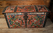 An old Hardanger chest from 1851 is colorfully decorated in red, green and blue patterns. The Hardanger Folk Museum was founded in 1911 in Utne, Norway.