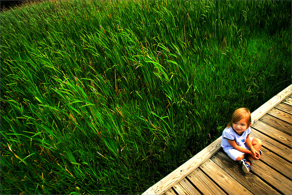 """A young child enjoys a slice of what """"Mother Nature"""" has to offer on a boardwalk portion of the Appalachian Trail in Vernon, New Jersey on June 27, 2006."""