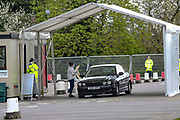 Frontline workers are tested at an NHS coronavirus drive through the testing facility at Chessington World of Adventure in Chessington, Britain on Tuesday, March 31 2020. Britain's Prime Minister Boris Johnson has implemented social distancing measures banning social gatherings and groups of more than two people. People must stand more than two metres apart. Several European countries have closed borders, schools as well as public facilities, and have cancelled most major sports and entertainment events in order to prevent the spread of the SARS-CoV-2 coronavirus causing the COVID-19 disease. (Photo/Vudi Xhymshiti)