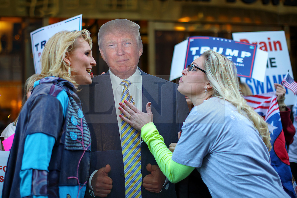 © Licensed to London News Pictures. 07/11/2016. New York CIty, USA. Donald Trump and Republican supporters get their picture taken with a cut-out of Presidential candidate Donald Trump outside Trump Tower in New York City on Monday, 7 November, the day before the presidential election day in the United States of America. Photo credit: Tolga Akmen/LNP