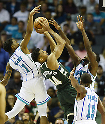 October 17, 2018 - Charlotte, NC, USA - The Milwaukee Bucks' Giannis Antetokounmpo (34) is surrounded by the Charlotte Hornets' Malik Monk (1), Michael Kidd-Gilchrist (14), and Kemba Walker (15) in the second half at the Spectrum Center in Charlotte, N.C., on Wednesday, Oct. 17, 2018. The Bucks won, 113-112. (Credit Image: © David T. Foster Iii/Charlotte Observer/TNS via ZUMA Wire)
