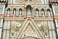 Statues of the Virgin Mary flanked by the Apostles and the  the fine Gothic architectural detail of  the  of the Gothic-Renaissance Duomo of Florence,  Basilica of Saint Mary of the Flower; Firenza ( Basilica di Santa Maria del Fiore ).  Built between 1293 & 1436. Italy .<br /> <br /> Visit our ITALY PHOTO COLLECTION for more   photos of Italy to download or buy as prints https://funkystock.photoshelter.com/gallery-collection/2b-Pictures-Images-of-Italy-Photos-of-Italian-Historic-Landmark-Sites/C0000qxA2zGFjd_k<br /> .<br /> <br /> Visit our MEDIEVAL PHOTO COLLECTIONS for more   photos  to download or buy as prints https://funkystock.photoshelter.com/gallery-collection/Medieval-Middle-Ages-Historic-Places-Arcaeological-Sites-Pictures-Images-of/C0000B5ZA54_WD0s