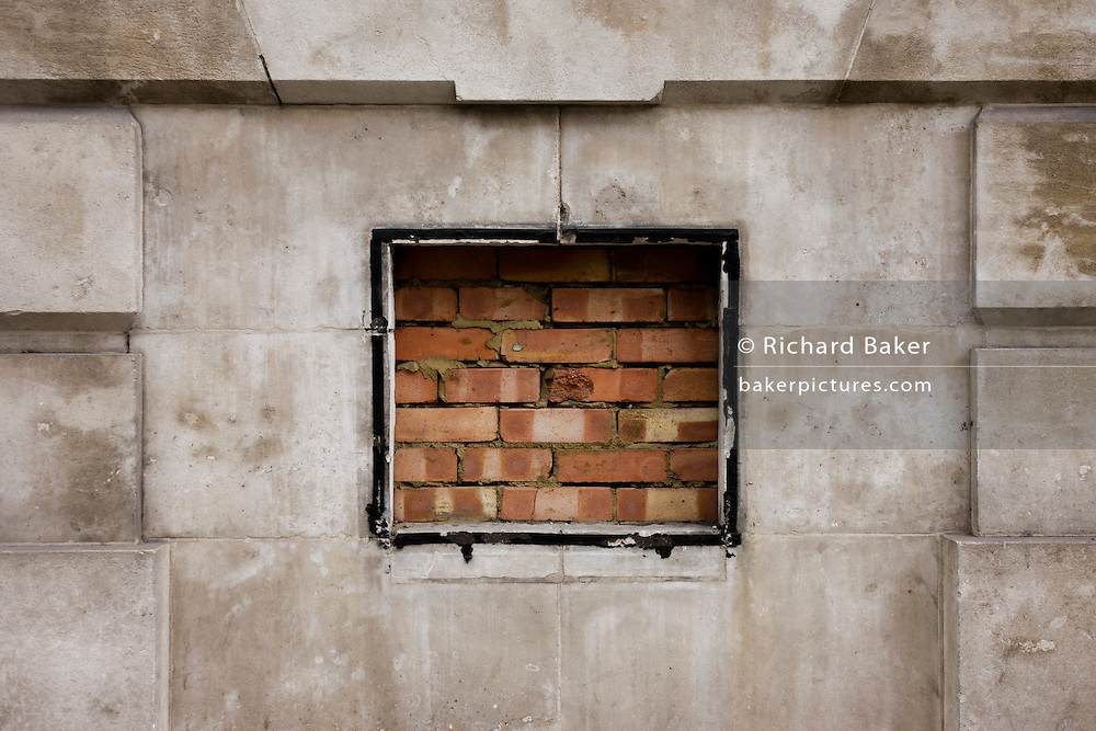 Bricked up hole in the wall, once a Midland Bank cash dispenser in the City of London.